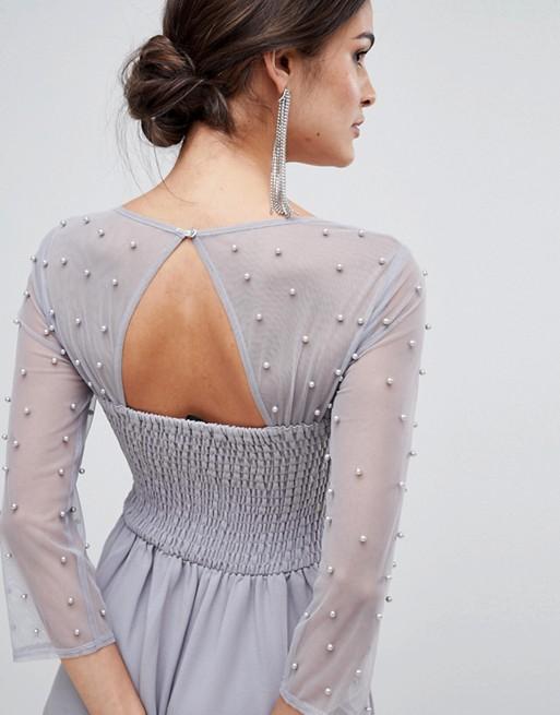 61d316045b45c96 Изящное вечернее платье классического кроя приталенного силуэта. Топ платья  украшен сетчатой накладкой с бусинками. Размер 48-50